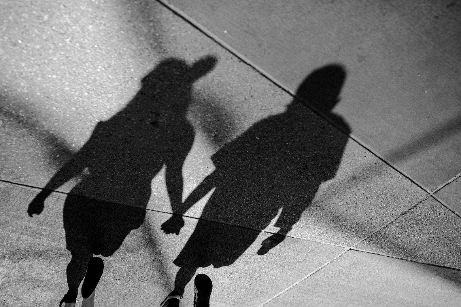 holding-hands-shadow-orlando-engagement-session-epcot-day-in-the-life.jpg