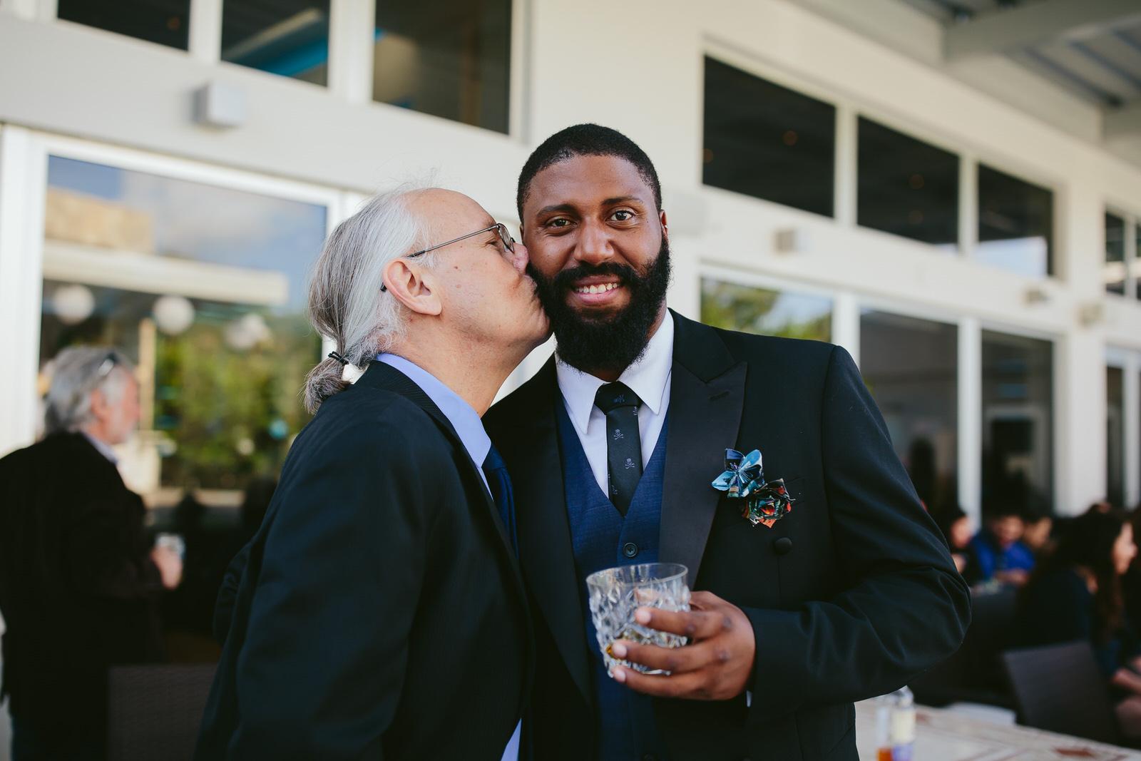 FOB-kissing-groom-candid-moments-wedding-photography.jpg