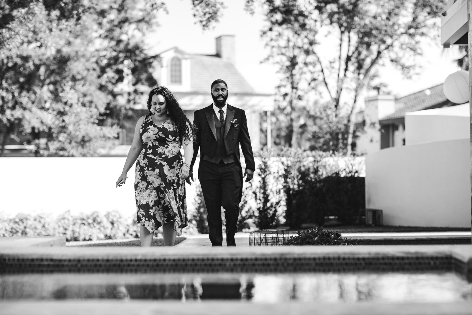 ceremony-walk-backyard-wedding-black-and-white-photography.jpg