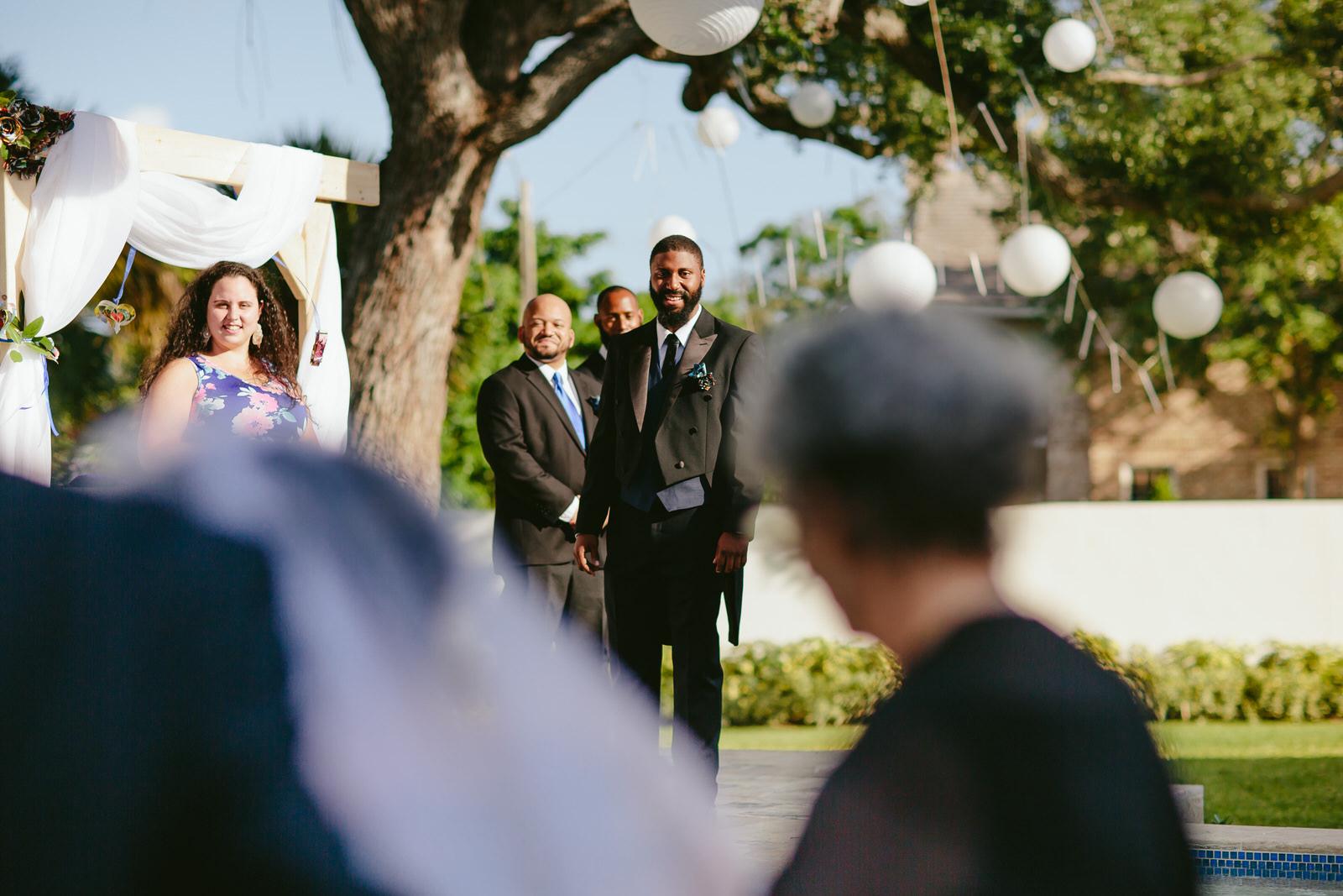 groom-first-look-ceremony-florida-backyard-wedding.jpg