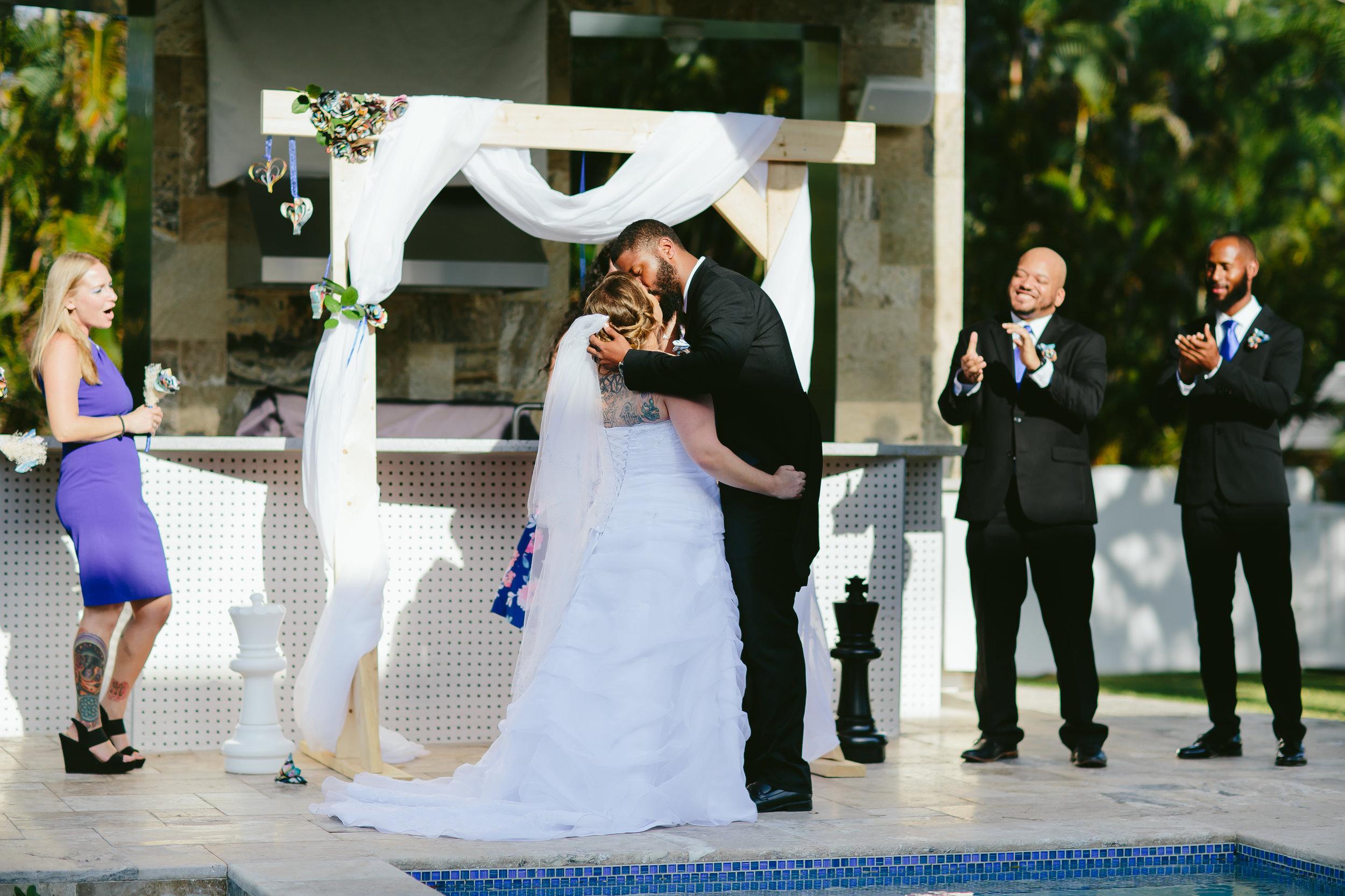 bride-groom-kiss-married-backyard-ceremony-diy-wedding.jpg