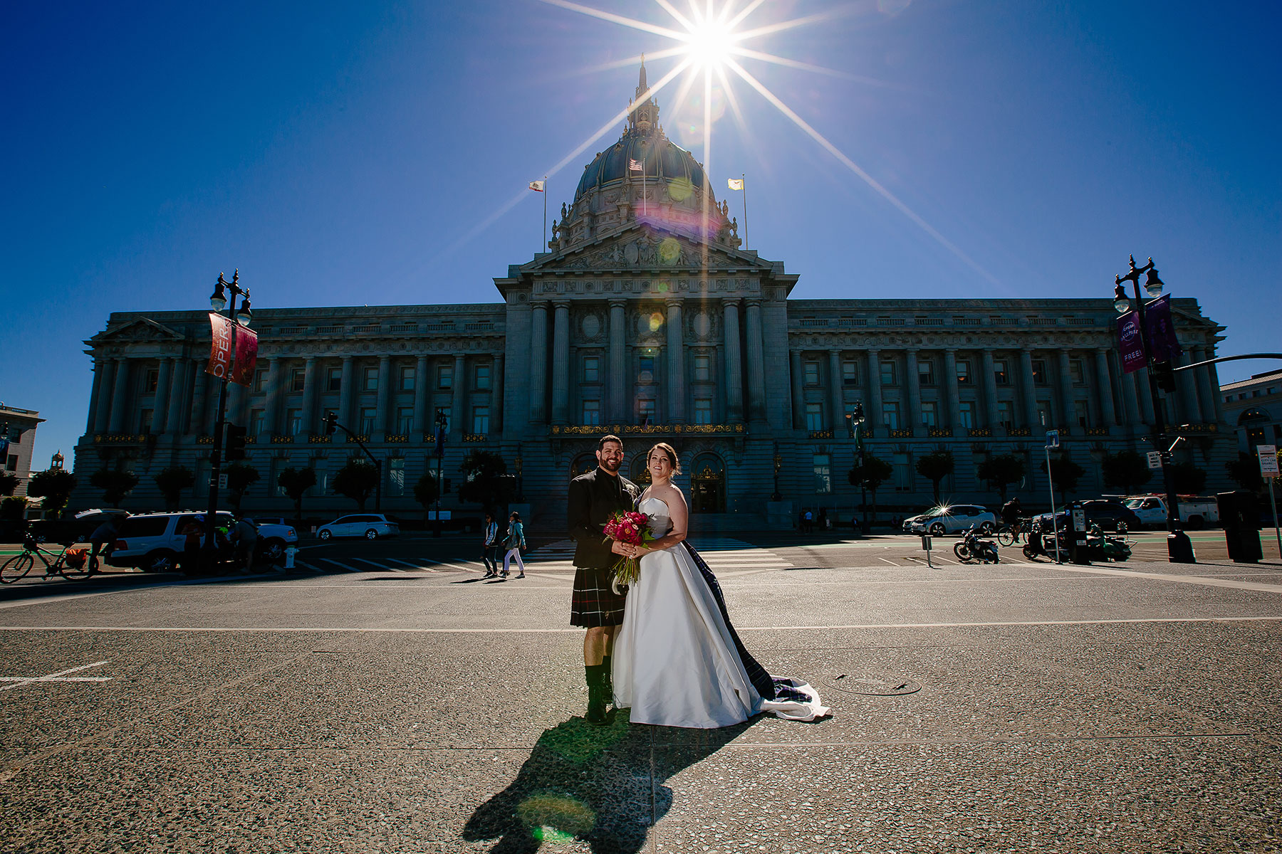 Beautiful bride and groom portrait in front of the San Francisco City Hall for Destination Wedding by Tiny House Photo
