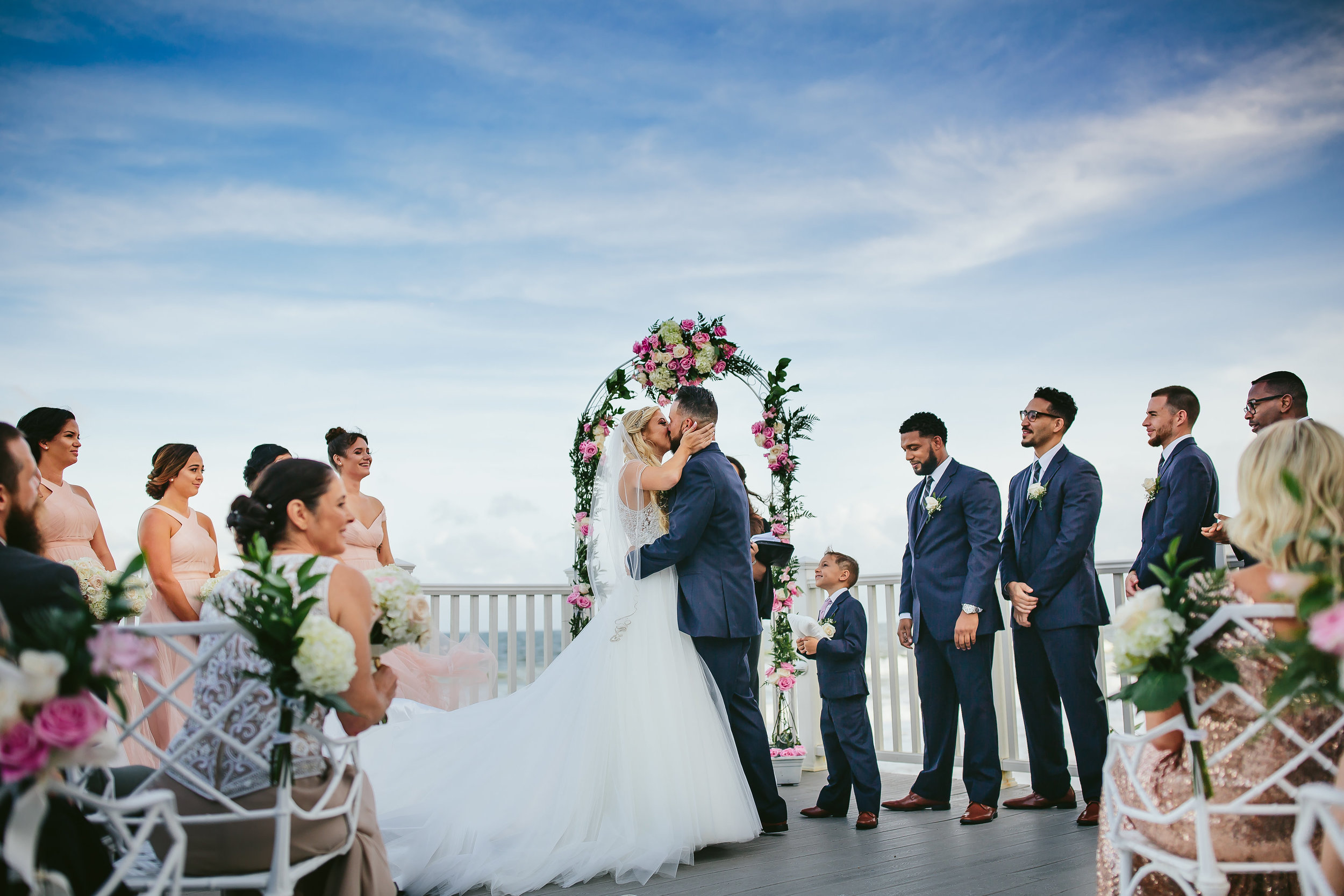 First Kiss Bride and Groom at the Hillsboro Lighthouse. Wedding Photography by Tiny House Photo.