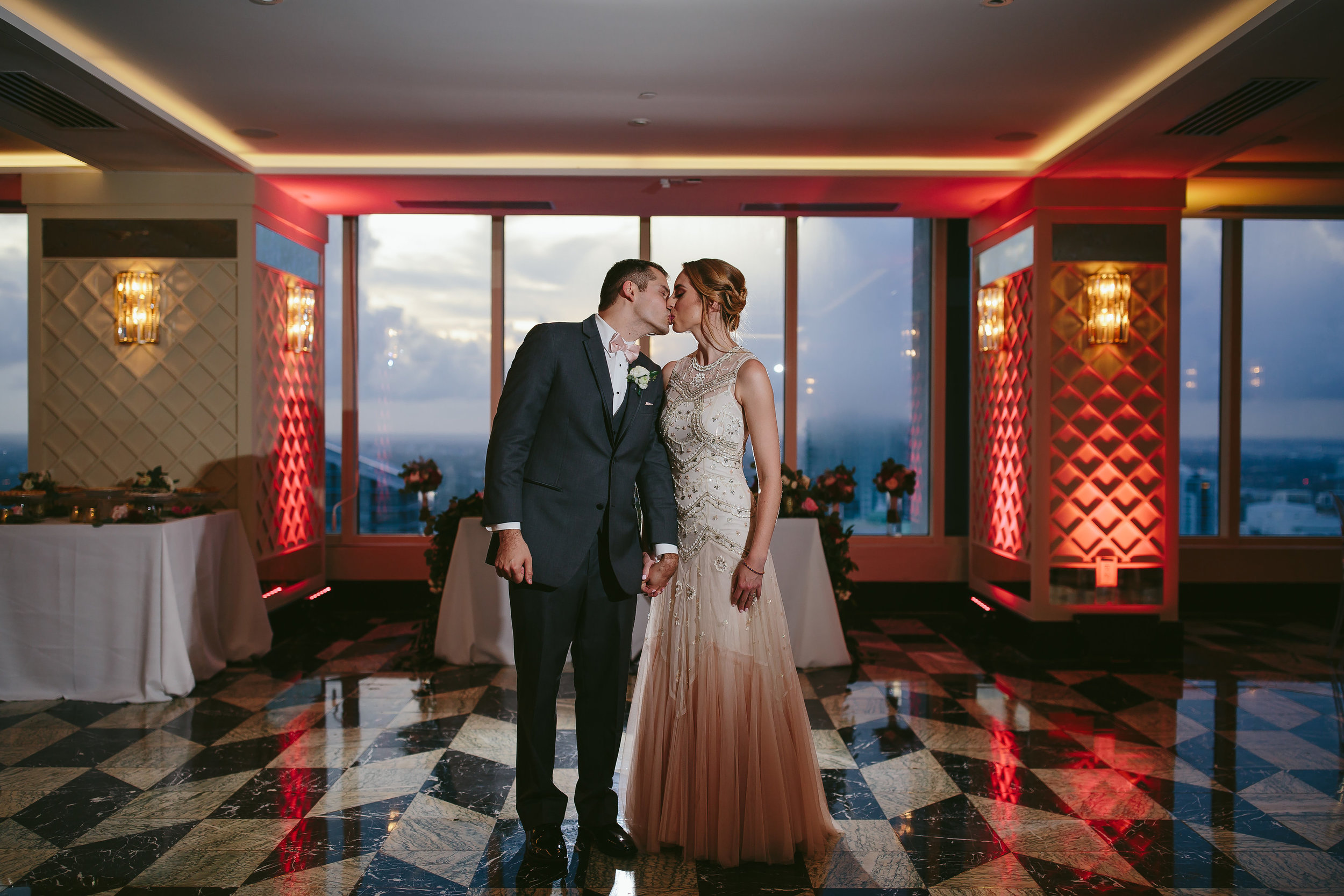 ballroom portrait of bride and groom kissing at the w hotel in brickell miami by tiny house photo