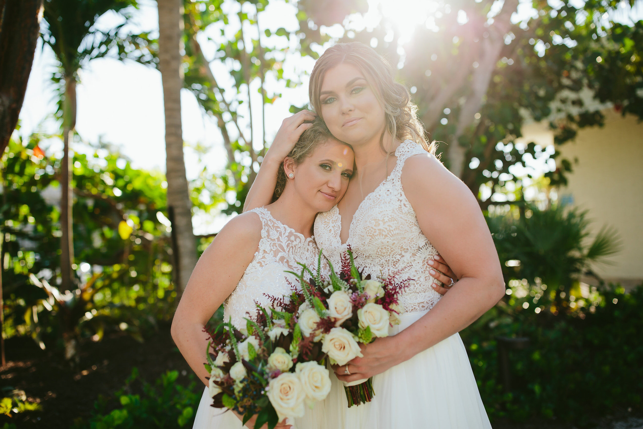 lesbian wedding in the florida keys. two brides embracing by tiny house photo