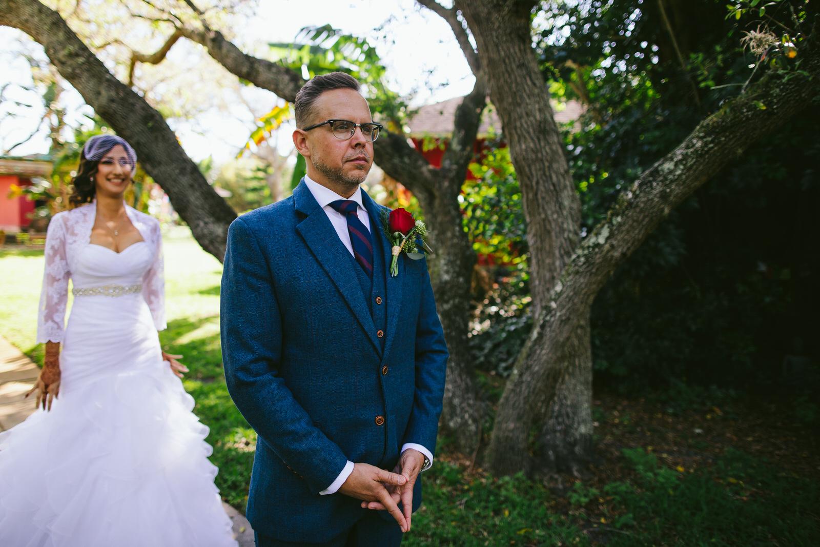 kashi-ashram-wedding-sebastian-florida-tiny-house-photo-first-look-bride-groom.jpg