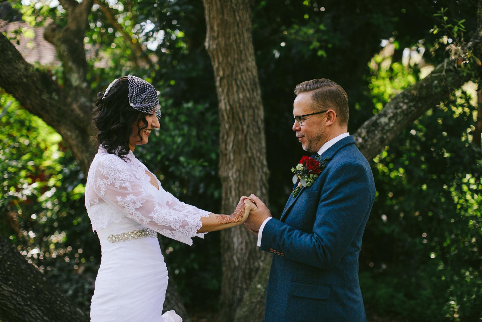 first-look-bride-groom-kashi-ashram-wedding-sebastian-florida-tiny-house-photo.jpg