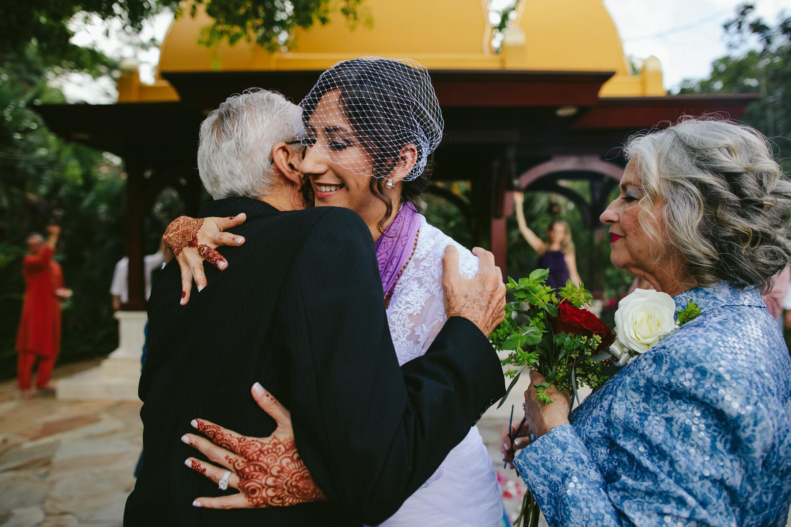 kashi-ashram-wedding-ceremony-bride-embracing-parents.jpg