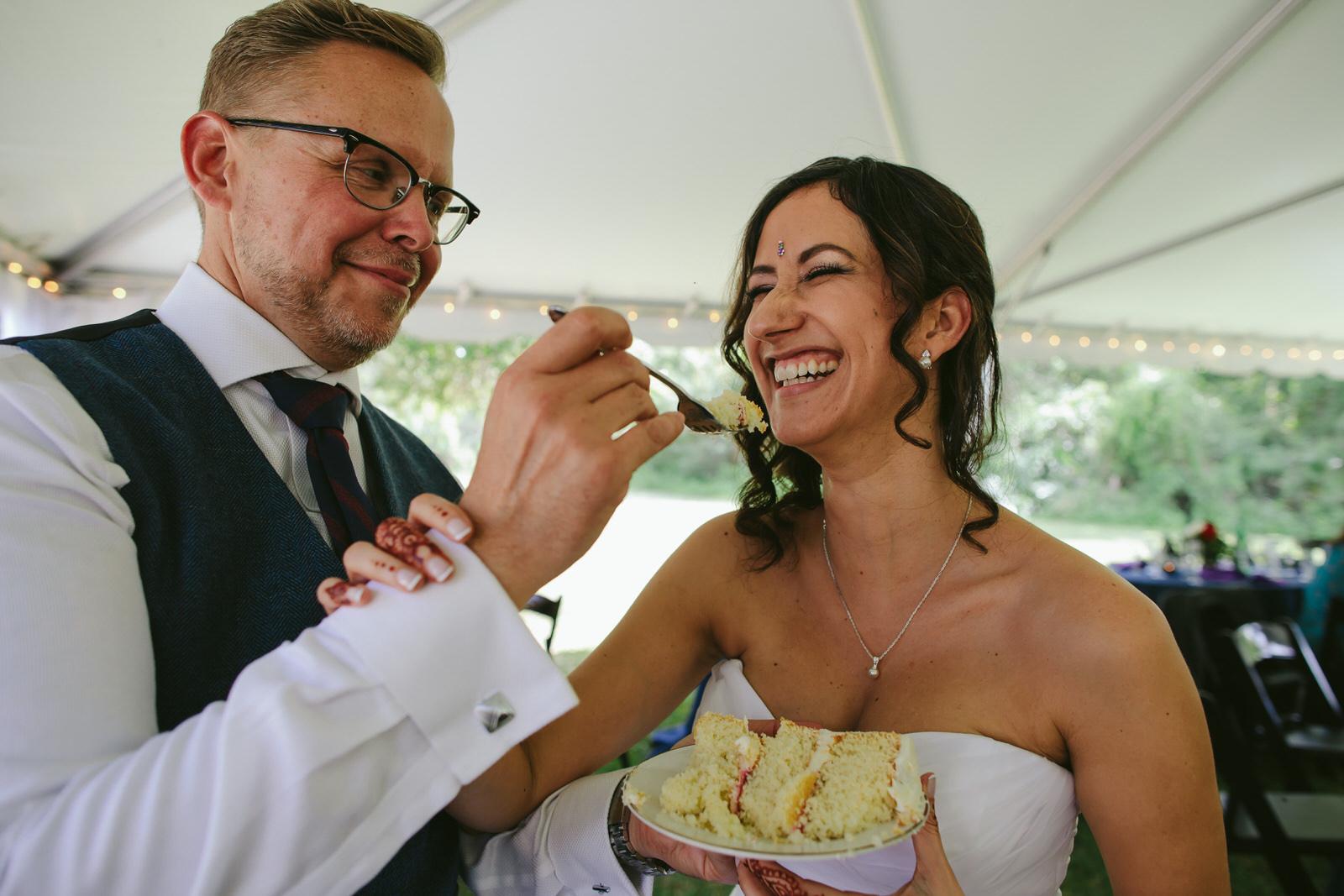 kashi-wedding-reception-tiny-house-photo-bride-groom-cake-moment.jpg