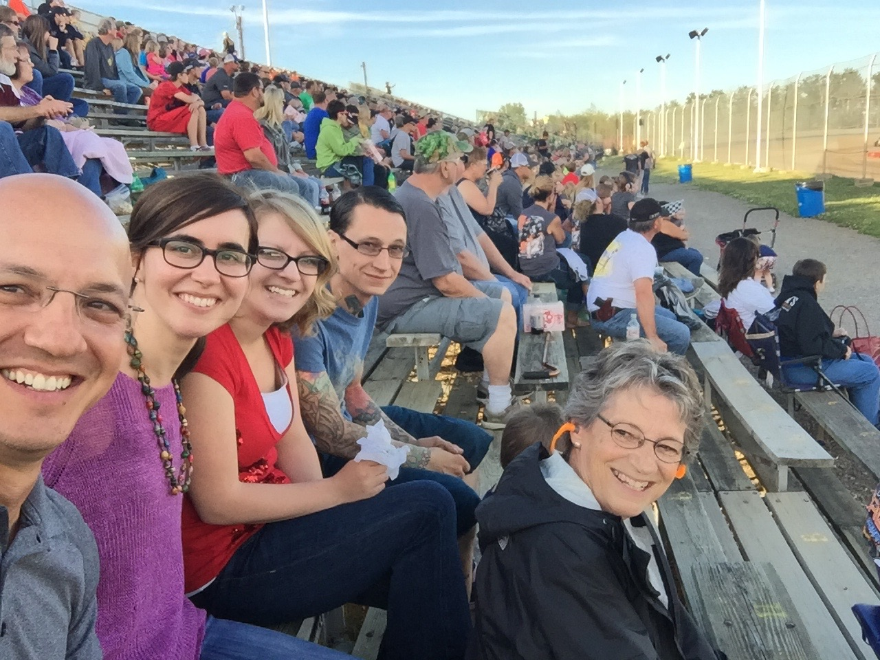 Geoff's mom with her sons   and their wives  take in some sports