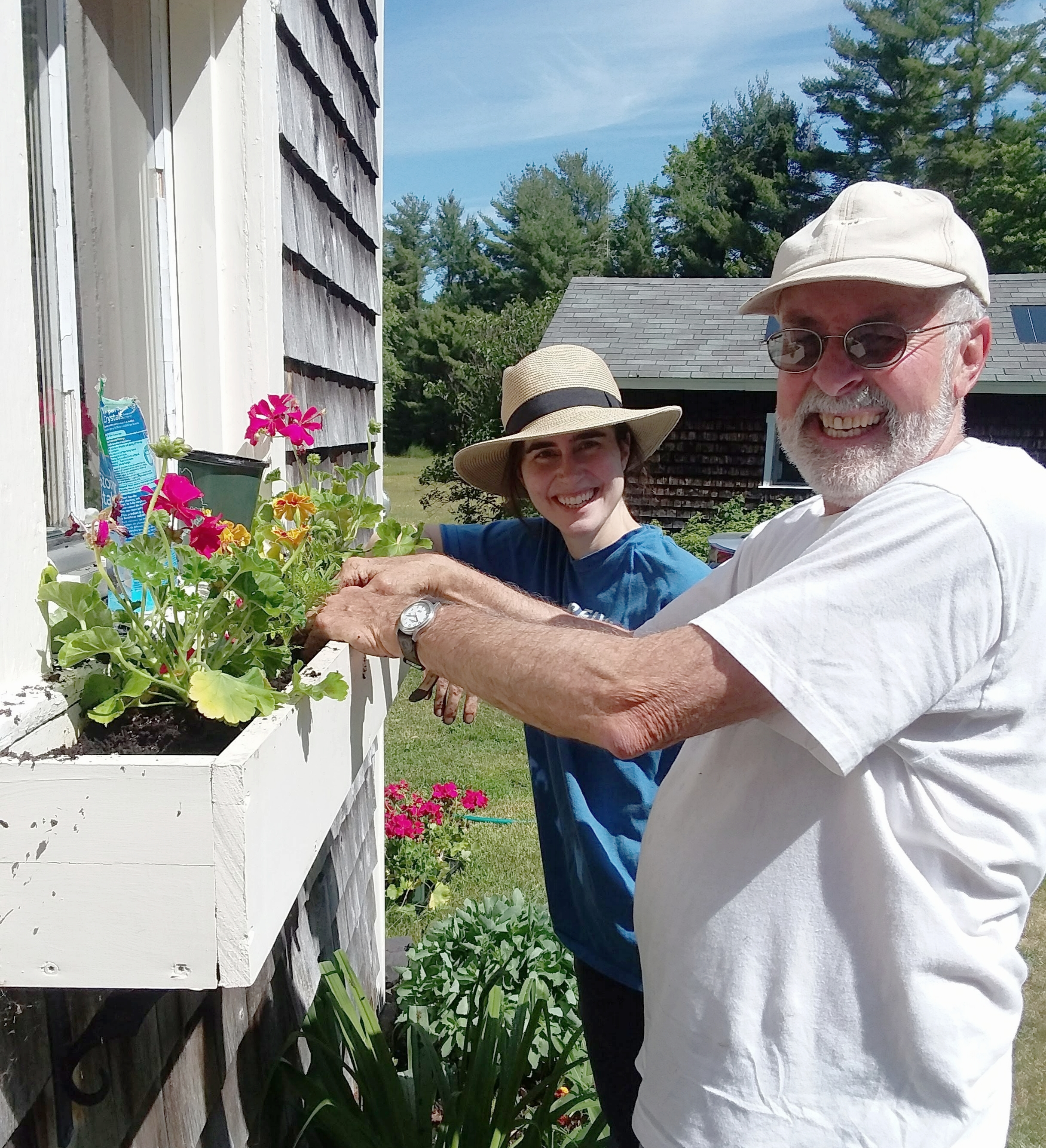 Alex and her dad  plant flowers at the family farm in Maine