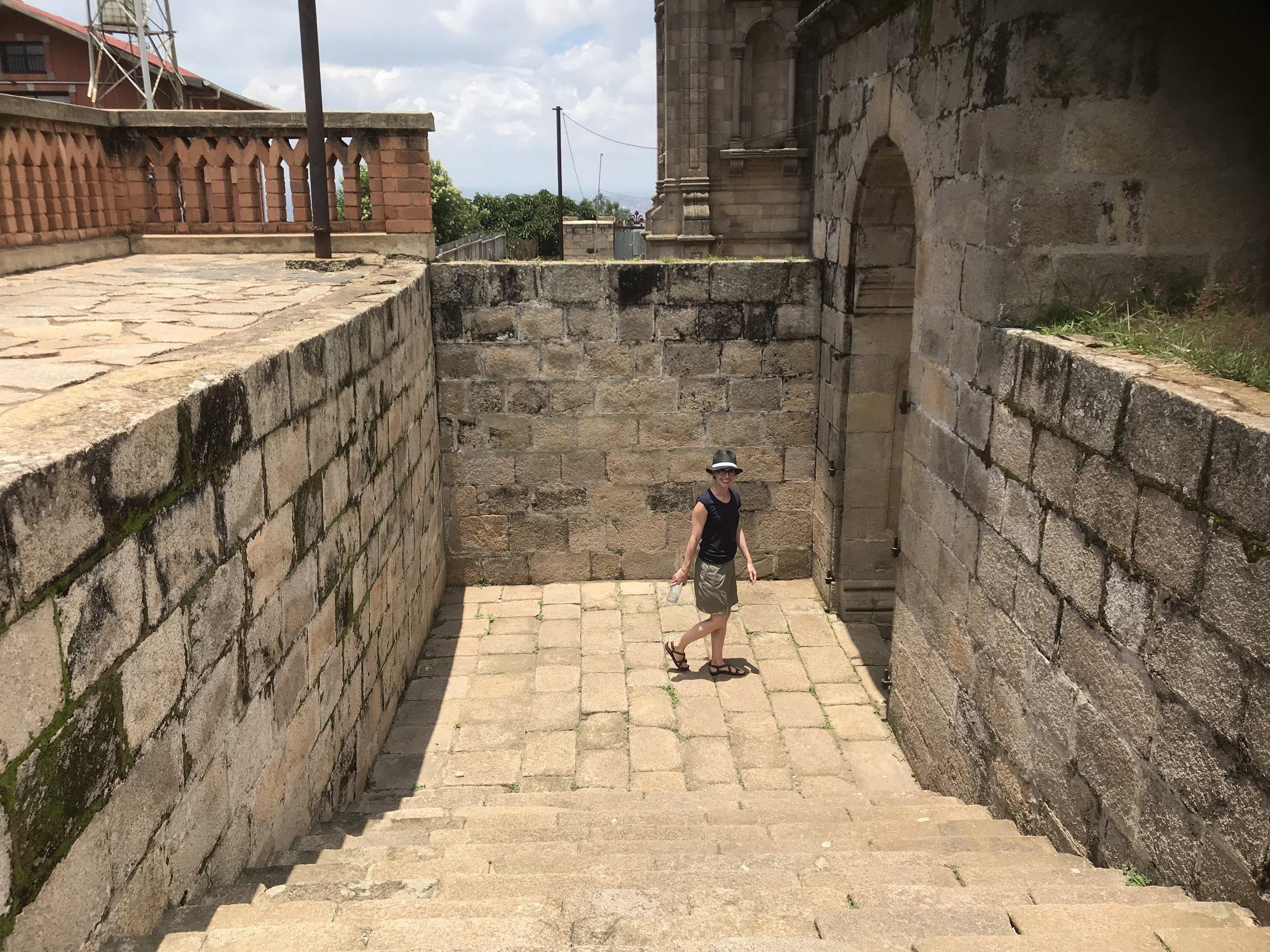 Alex admires some ancient ruins