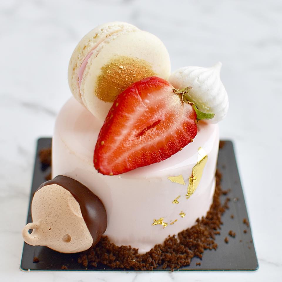 NEAPOLITAN *BEST SELLER*  Strawberry sponge base, milk chocolate mousse, white chocolate and vanilla mousse, mirror glaze, strawberry and vanilla macaron, chocolate dipped meringue.  $7.90 each  Minimum Order Quantity : 8   THIS ITEM CONTAINS NUTS