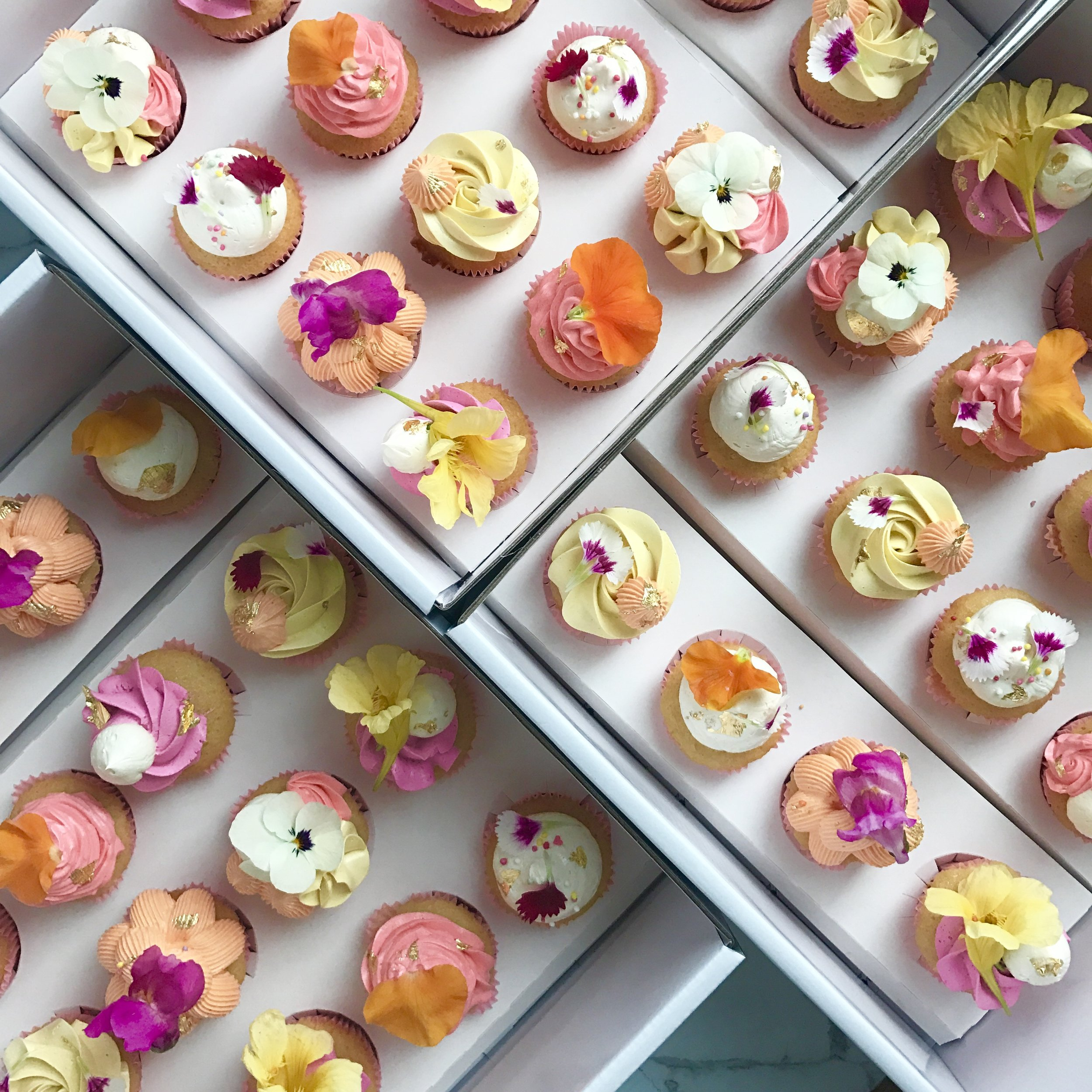 BABY SIZE BUTTERCREAM CUPCAKES WITH EDIBLE FLOWERS  From: $2.50 each  Minimum Order Quantity : 24 Per Flavour