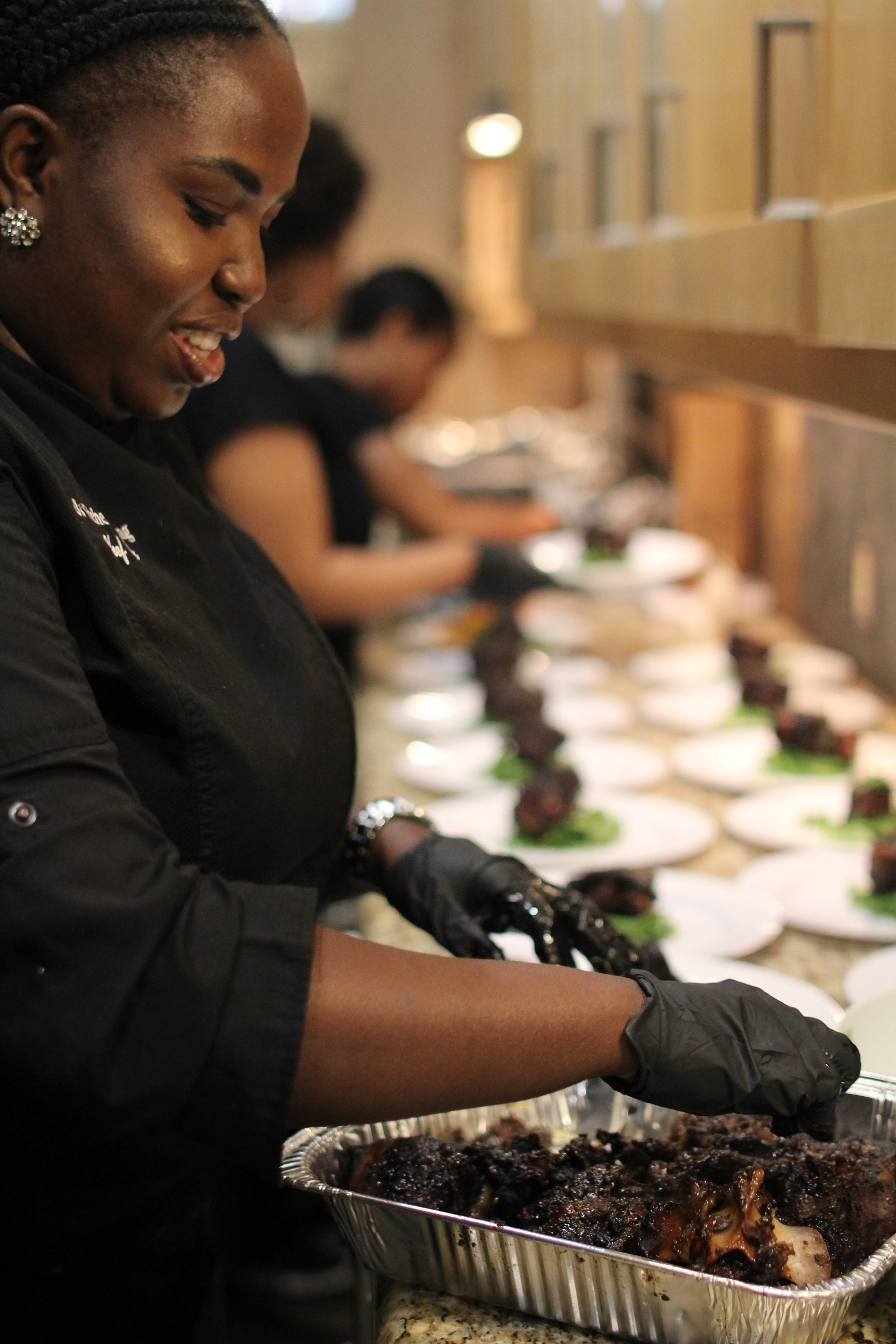 Chef Ola plating braised jerk oxtails