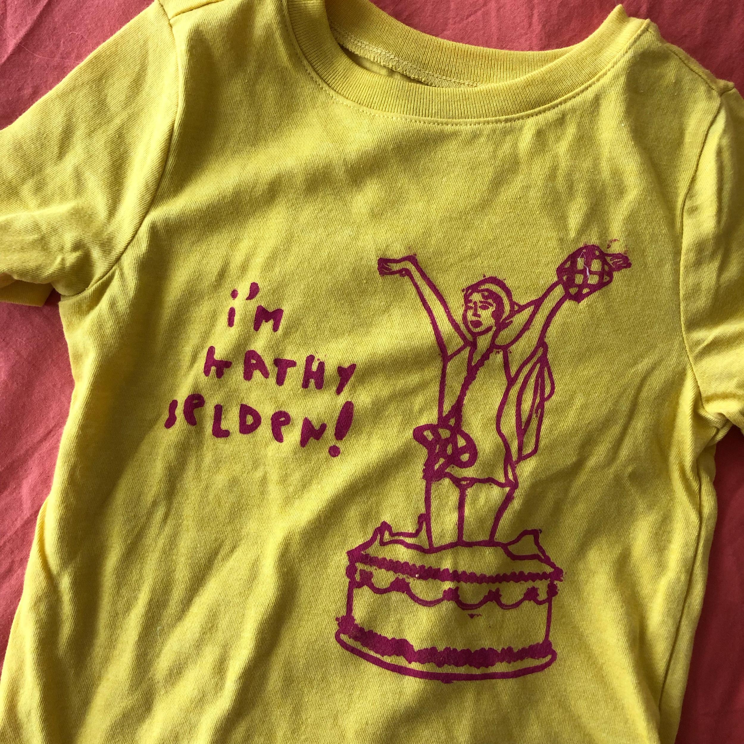 kushins_kathy_selden_stamp_shirt.jpeg