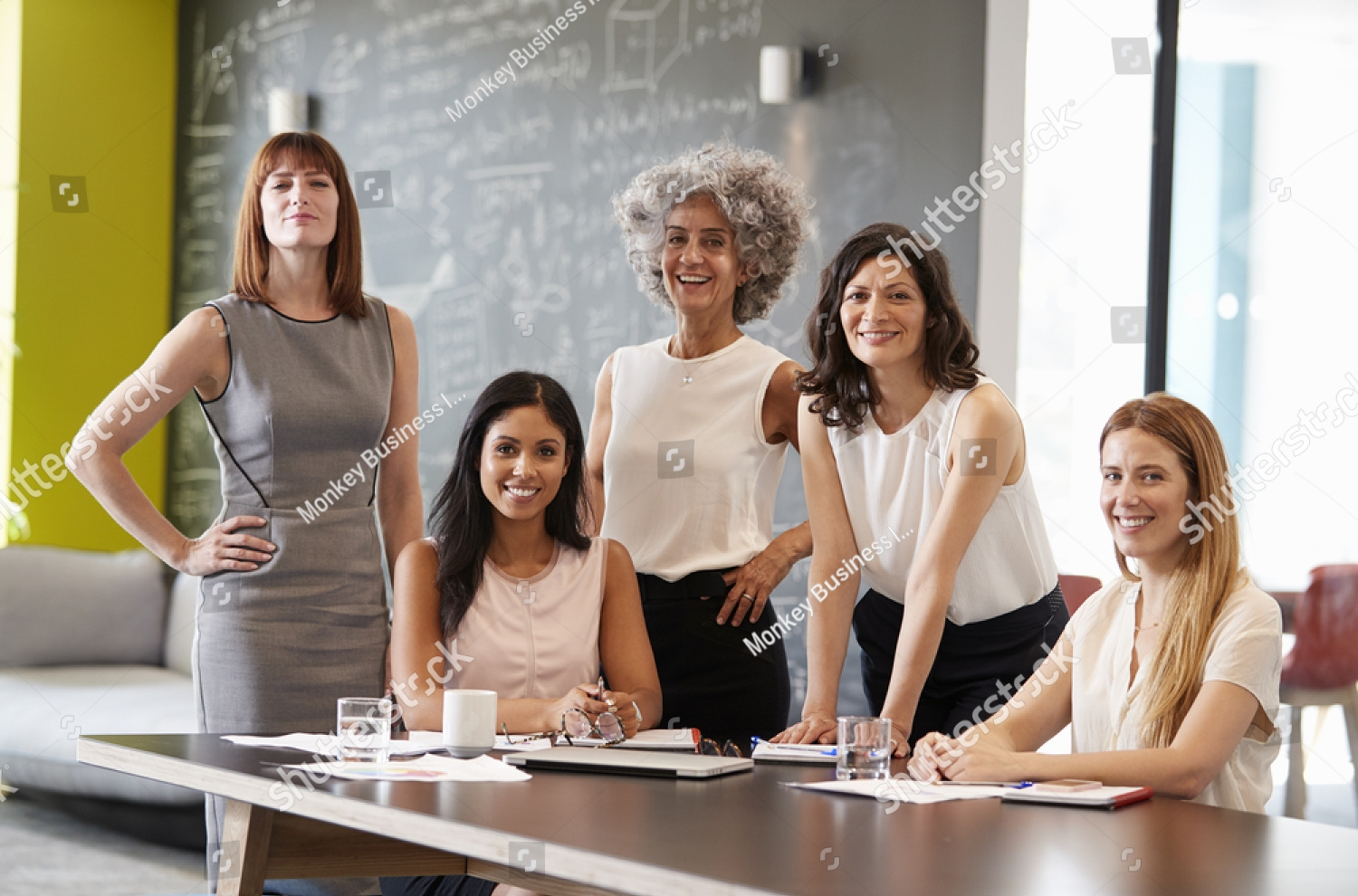 stock-photo-five-female-colleagues-at-a-work-meeting-smiling-to-camera-749253997.jpg