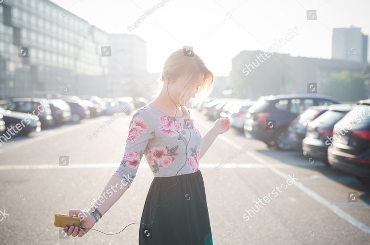 stock-photo-young-beautiful-blonde-woman-outdoor-in-the-street-of-the-city-listening-music-and-using-smartphone-253743220 (1).jpg