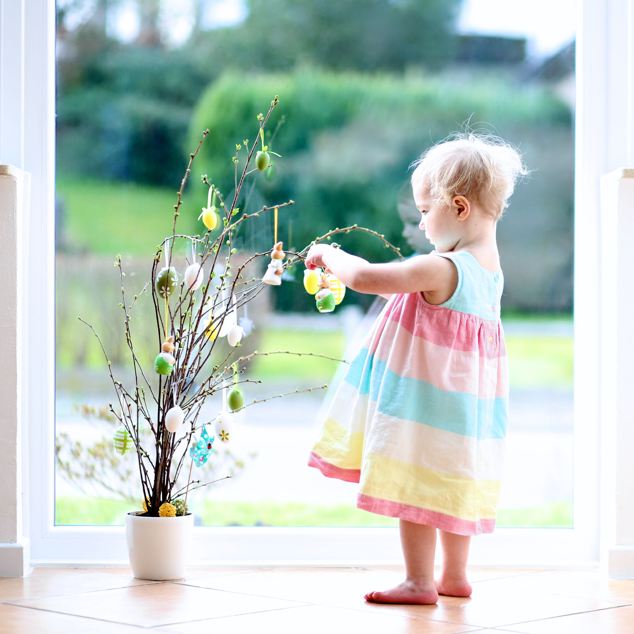 Dressing the Easter tree/twigs (photo by CroMary via Shutterstock)