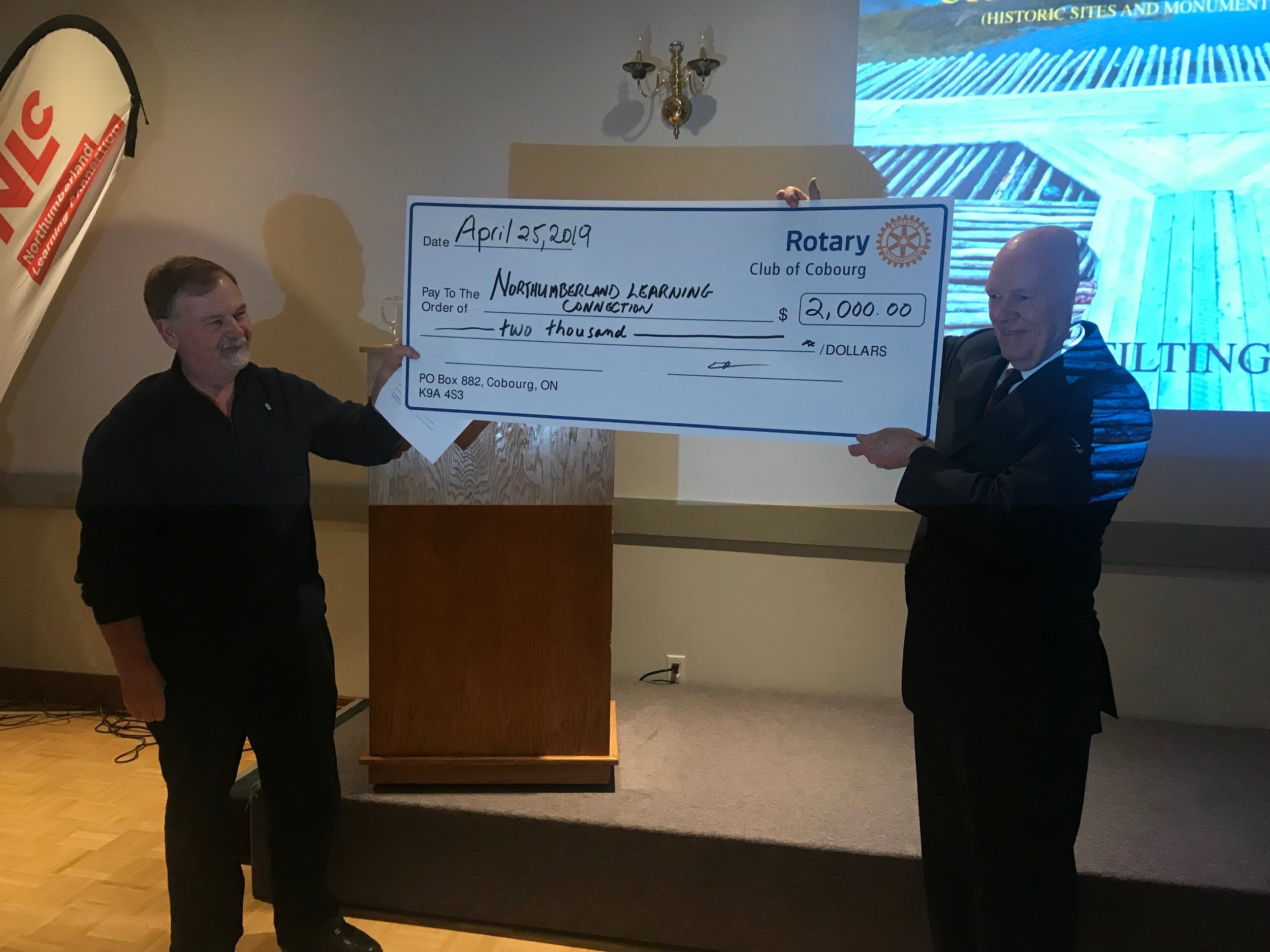 Rotary Club of Cobourg's Rick Riley presents a cheque to NLC Chair Wayne Lang