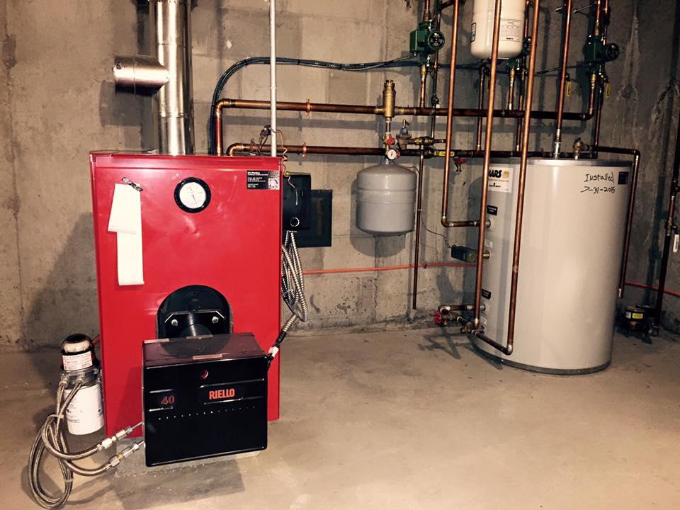 Tortis_Biasi_B-10 triple pass oil-fired boiler w-Riello burner assembly.jpg