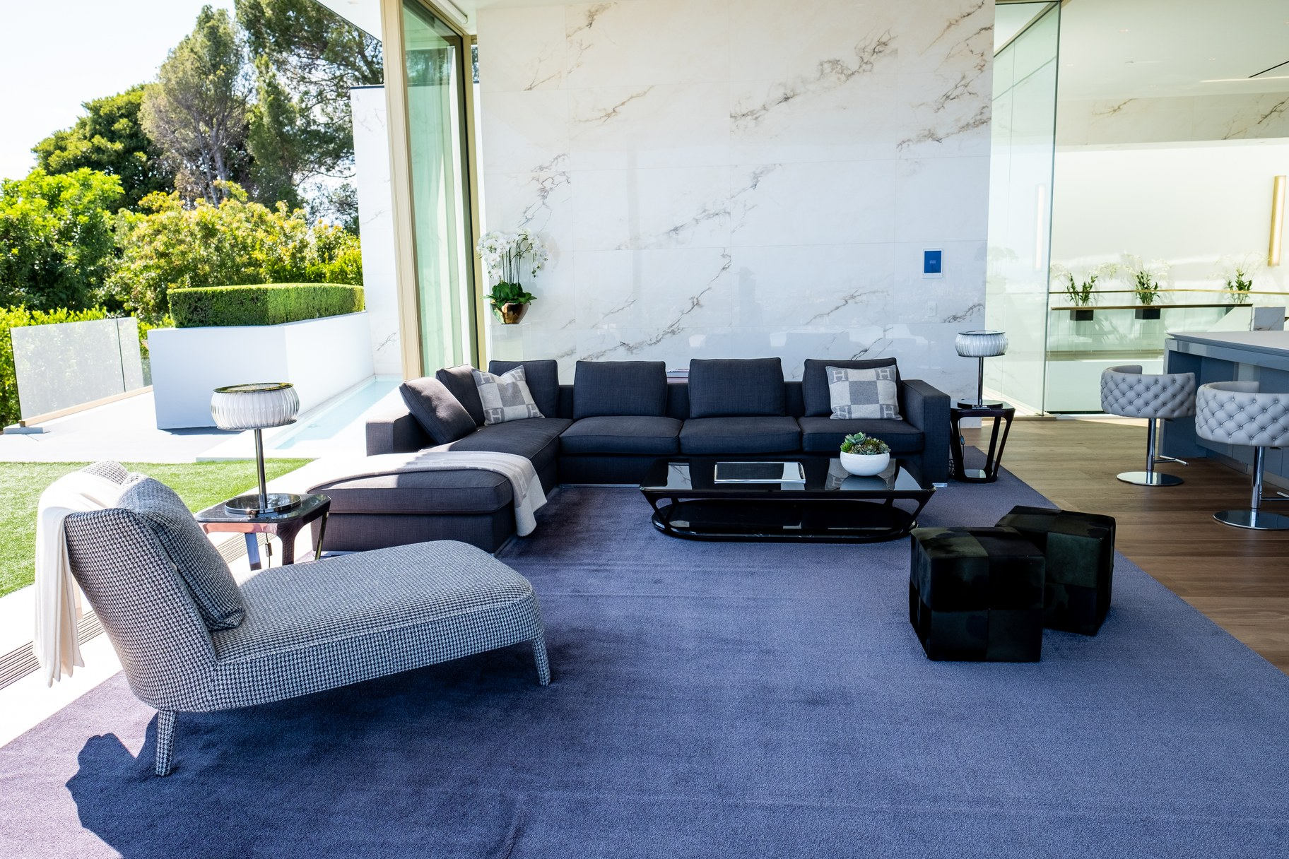 A lounge area next to the patio and kitchen.