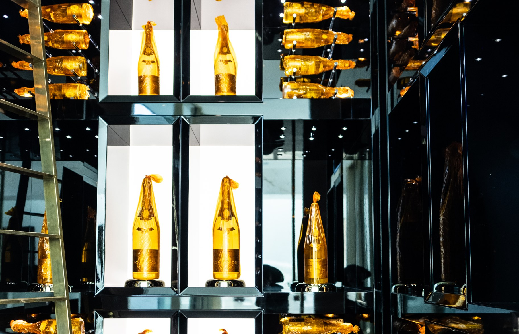 The champagne cellar with a gold ladder.
