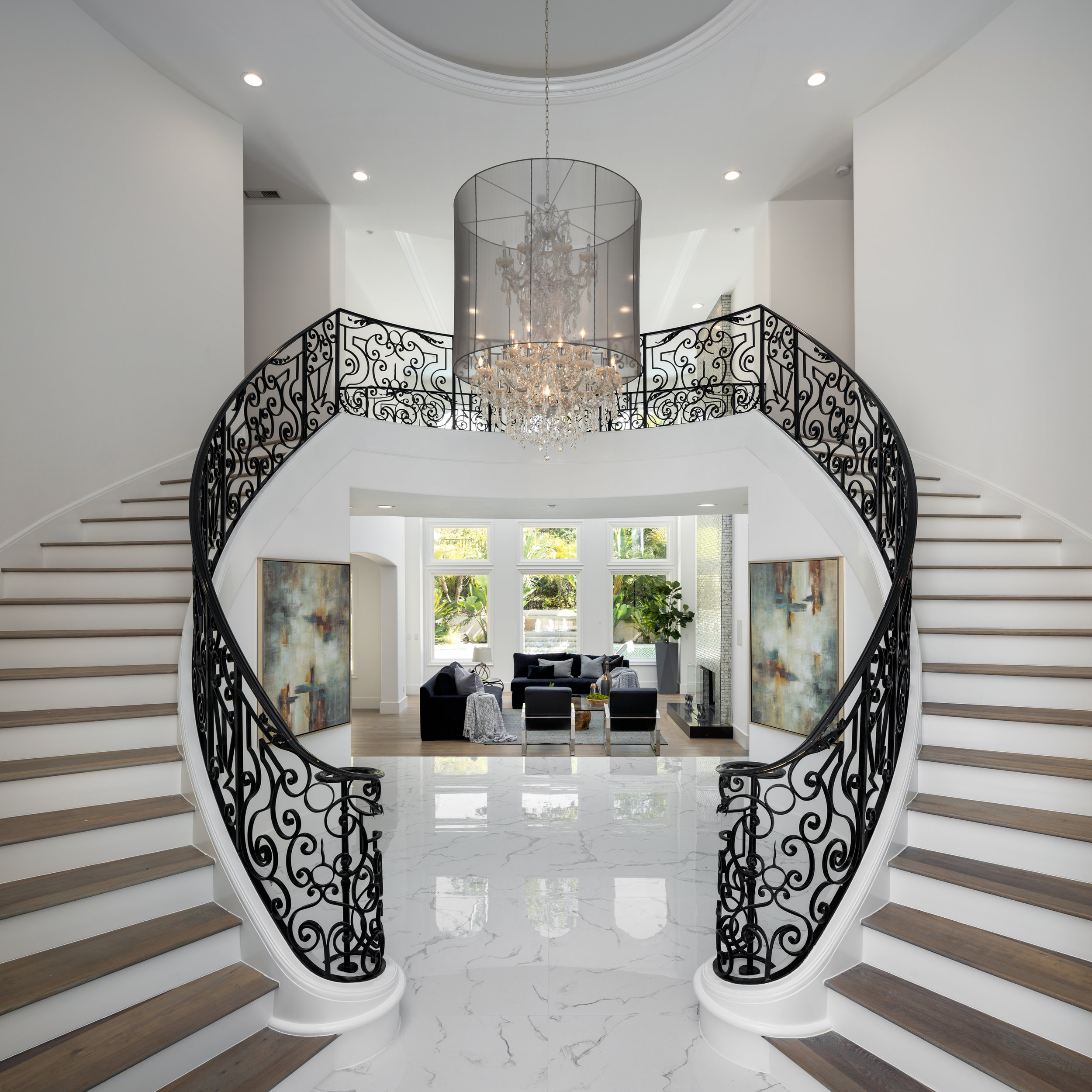 The foyer with dual staircases (Hilton & Hyland)