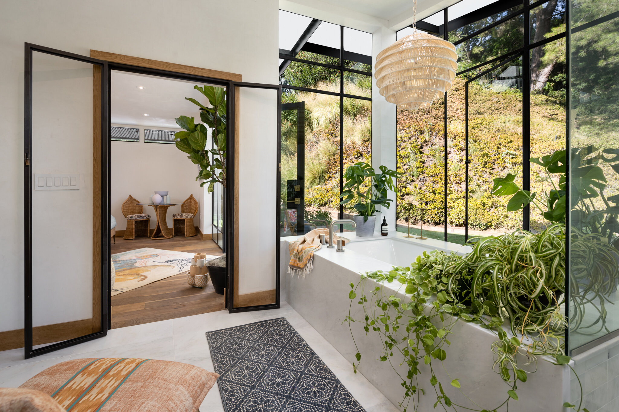 Custom steel-framed windows bring garden views into the bathroom of the latest home project by artist-designer Kim Gordon. The reimagined Midcentury Modern-style house is going on the market in the Hollywood Hills for $3.25 million. (Tyler Hogan)