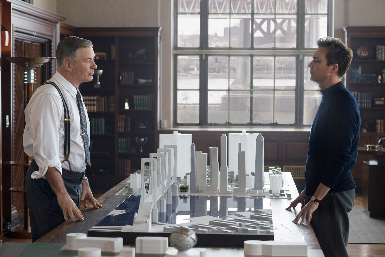 """Alec Baldwin as Moses Randolph and Edward Norton as Lionel Essrog. Randolph is based closely on the real-life New York City """"master builder"""" Robert Moses."""