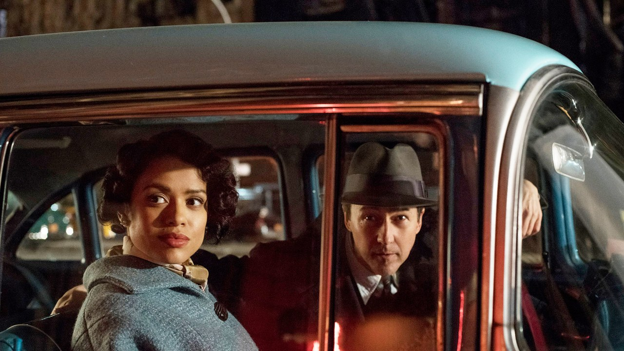 """Gugu Mbatha-Raw as Laura Rose and Edward Norton as Lionel Essrog. As a black female lawyer in 1950s New York and a detective with Tourette's Syndrome, both Laura and Lionel are """"not being seen for who they really are,"""" says Norton."""