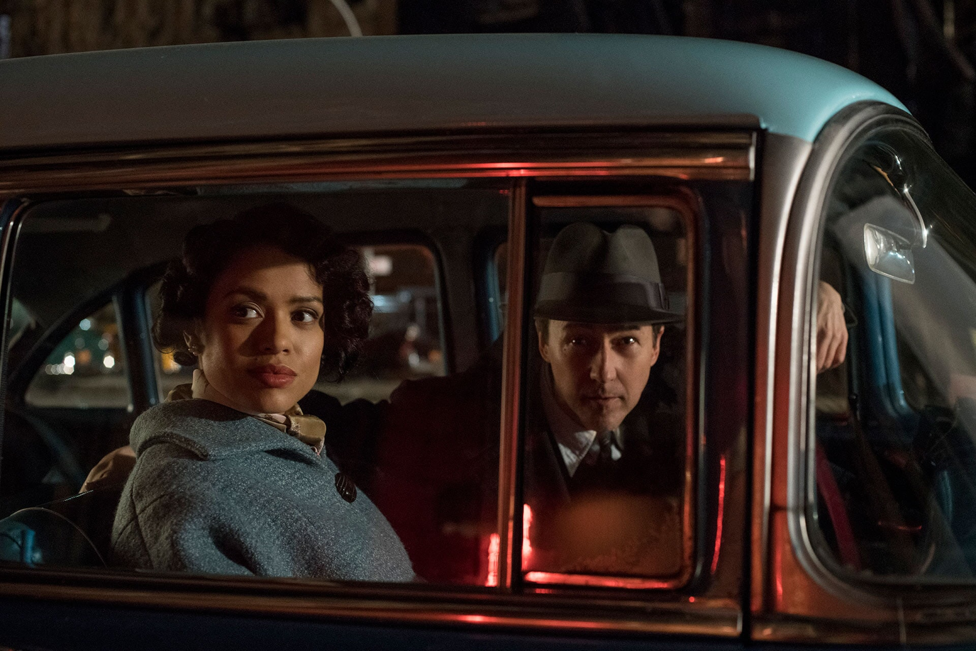 "Gugu Mbatha-Raw as Laura Rose and Edward Norton as Lionel Essrog in the drama ""Motherless Brooklyn,"" which will be put to the test at this month's Toronto International Film Festival. (Glen Wilson/Warner Bros.)"