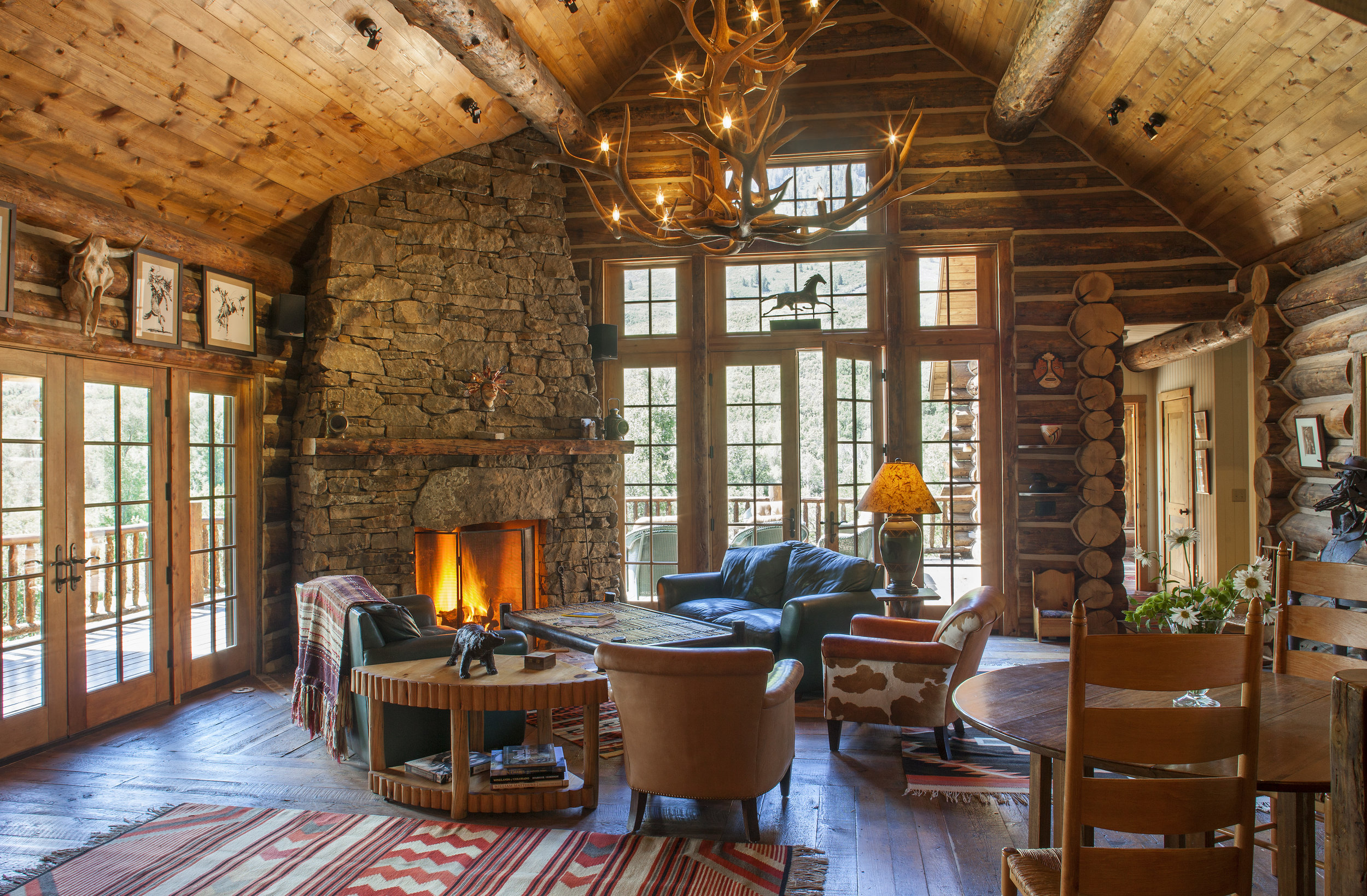 Great Room at the Hill House with Grand, Welcoming Rock Fireplace