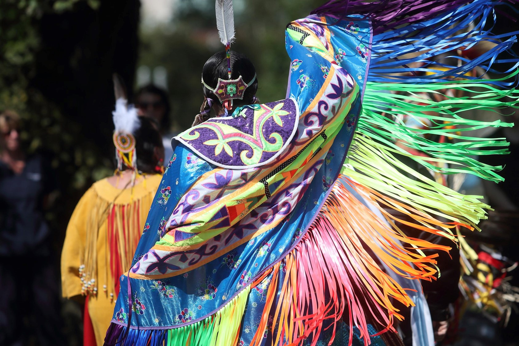 Above: A jingle dancer participates in the Mawiomi during 2018 Welcome Weeks.