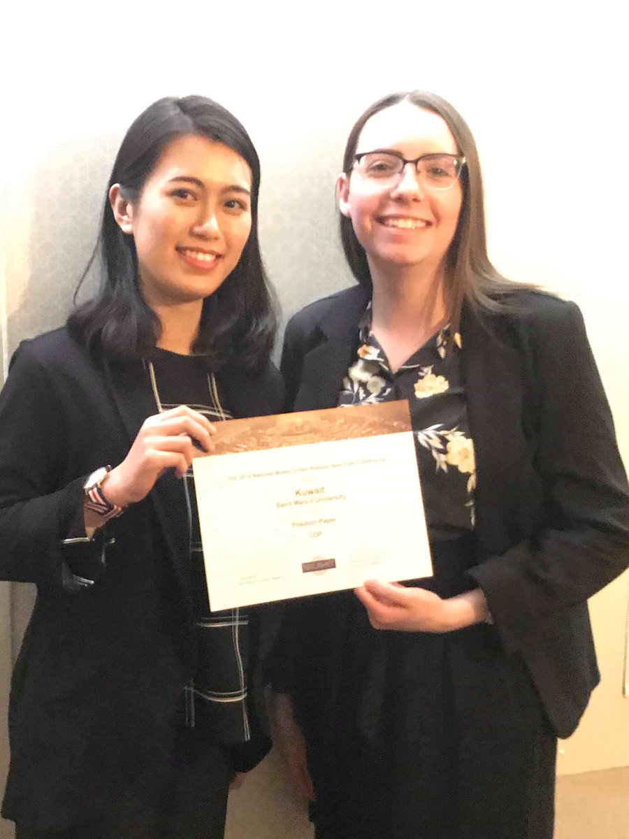 Students Yankun Li and Hannah Shuttleworth took home an  Outstanding Position Paper  award!