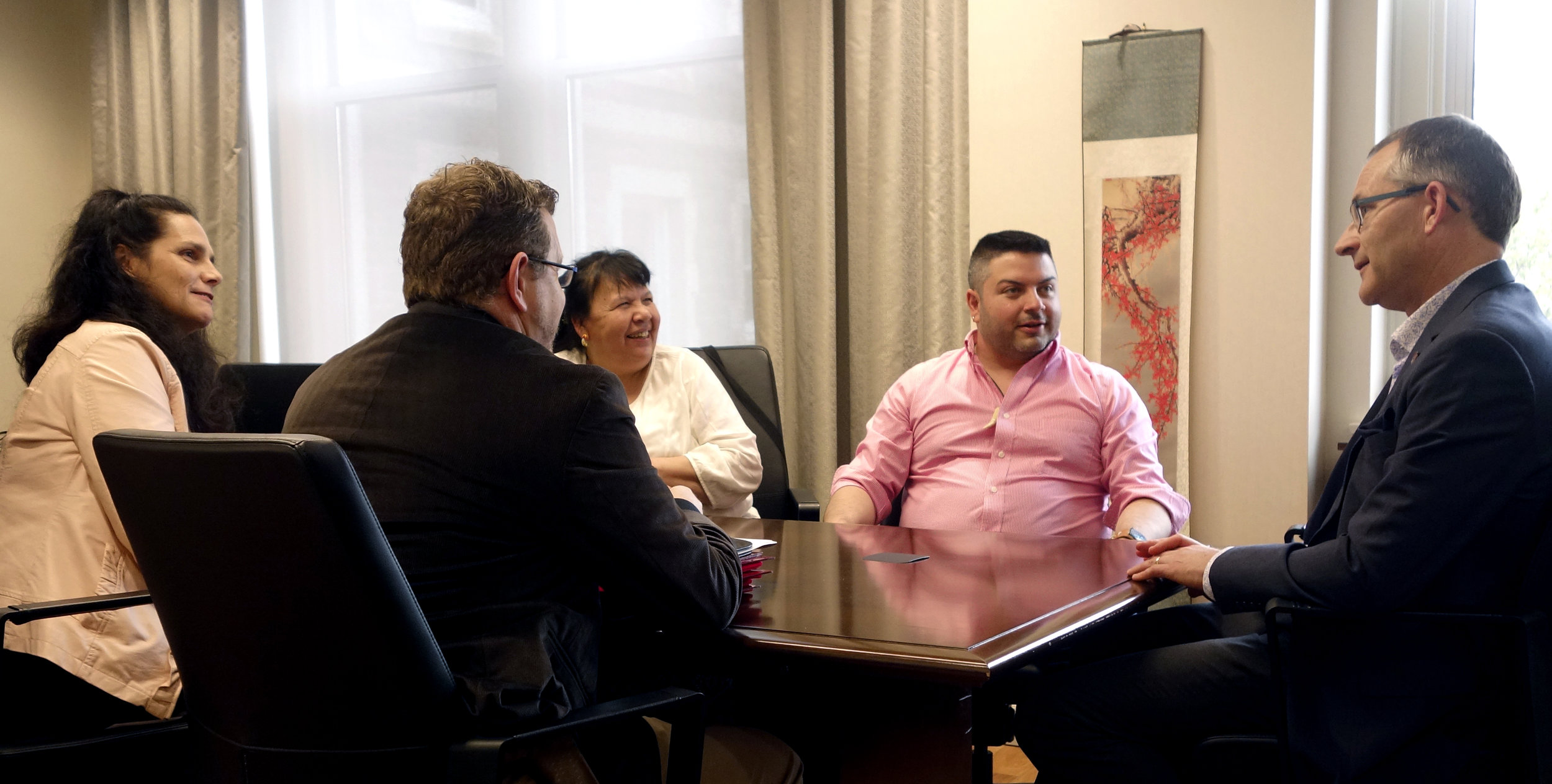 Pictured l-r: Pam Glode-Desrochers, Executive Director of the Mi'kmaw Native Friendship Centre; Tom Brophy, Senior Director, Student Affairs & Services; Elder Debbie Eisan; Indigenous Advisor Raymond Sewell; and President Summerby-Murray chat before signing the new MOU.