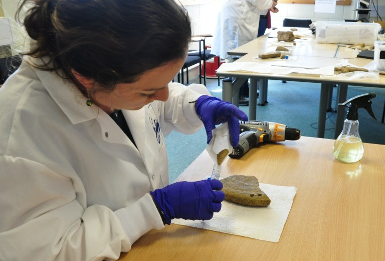 Dr. Frasier creating a sample from a whalebone.