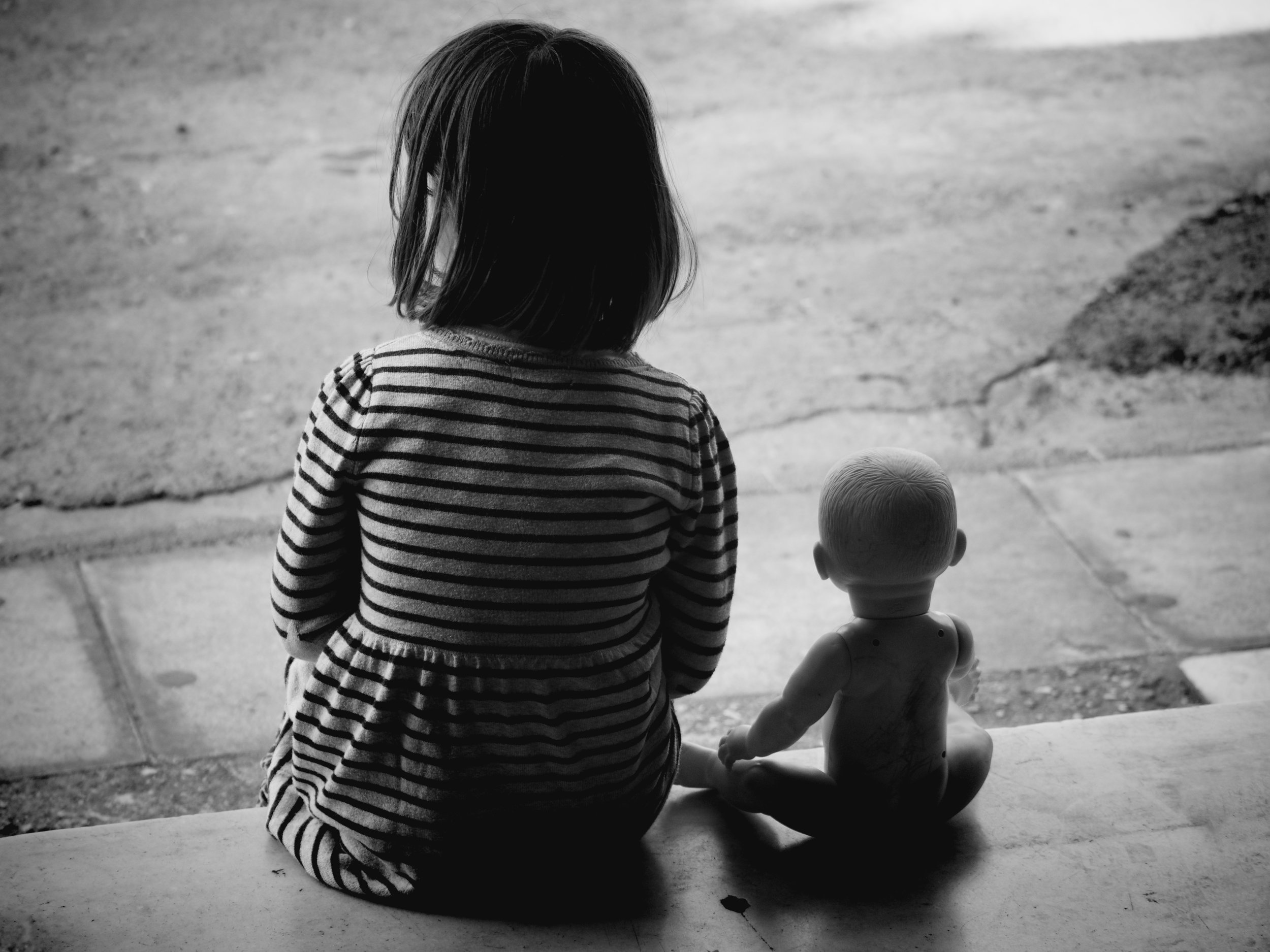 A girl and her doll