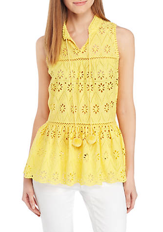 It doesn't come in white at Belk but it does come in yellow, coral, navy, or navy and get this its $15.59---$32.75as of this writing, and I actually like the pom poms better than the tassels on the Kate Spade. I have this top in the yellow and the navy and I literally get stopped several times every time I wear it! -