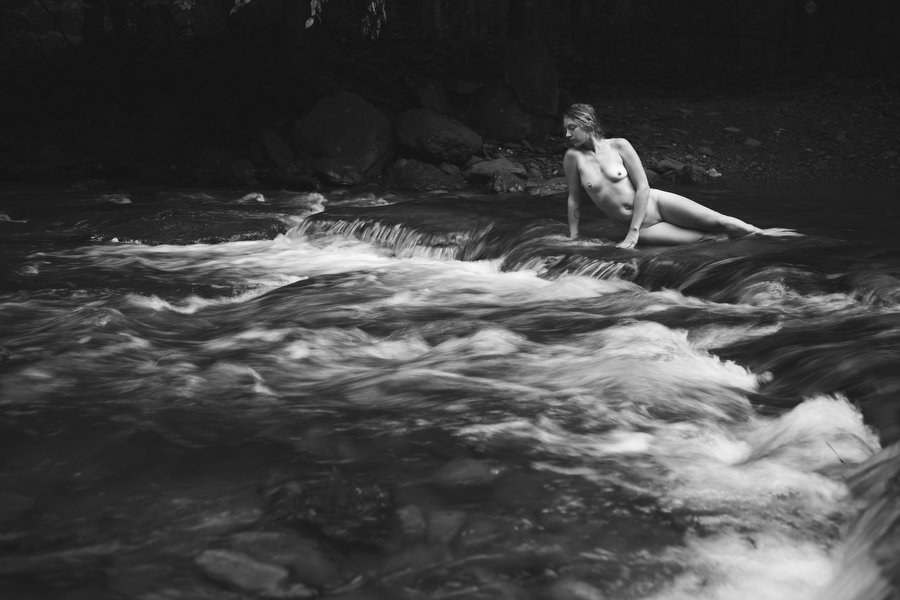 fine art nude in nature in river by waterfall outdoor boudoir photography in nature