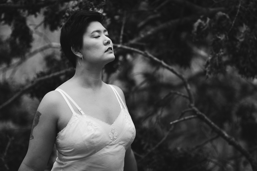 outdoor boudoir photography in woods forest white slip asian woman red lips