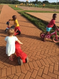 Anavah's bike gang on campus:). Although it did turn into a toddler fight over her bodaboda (motorcycle).