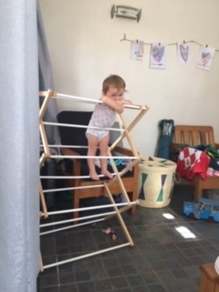 When there are not parks with playgrounds…the drying rack becomes the climbing gym!