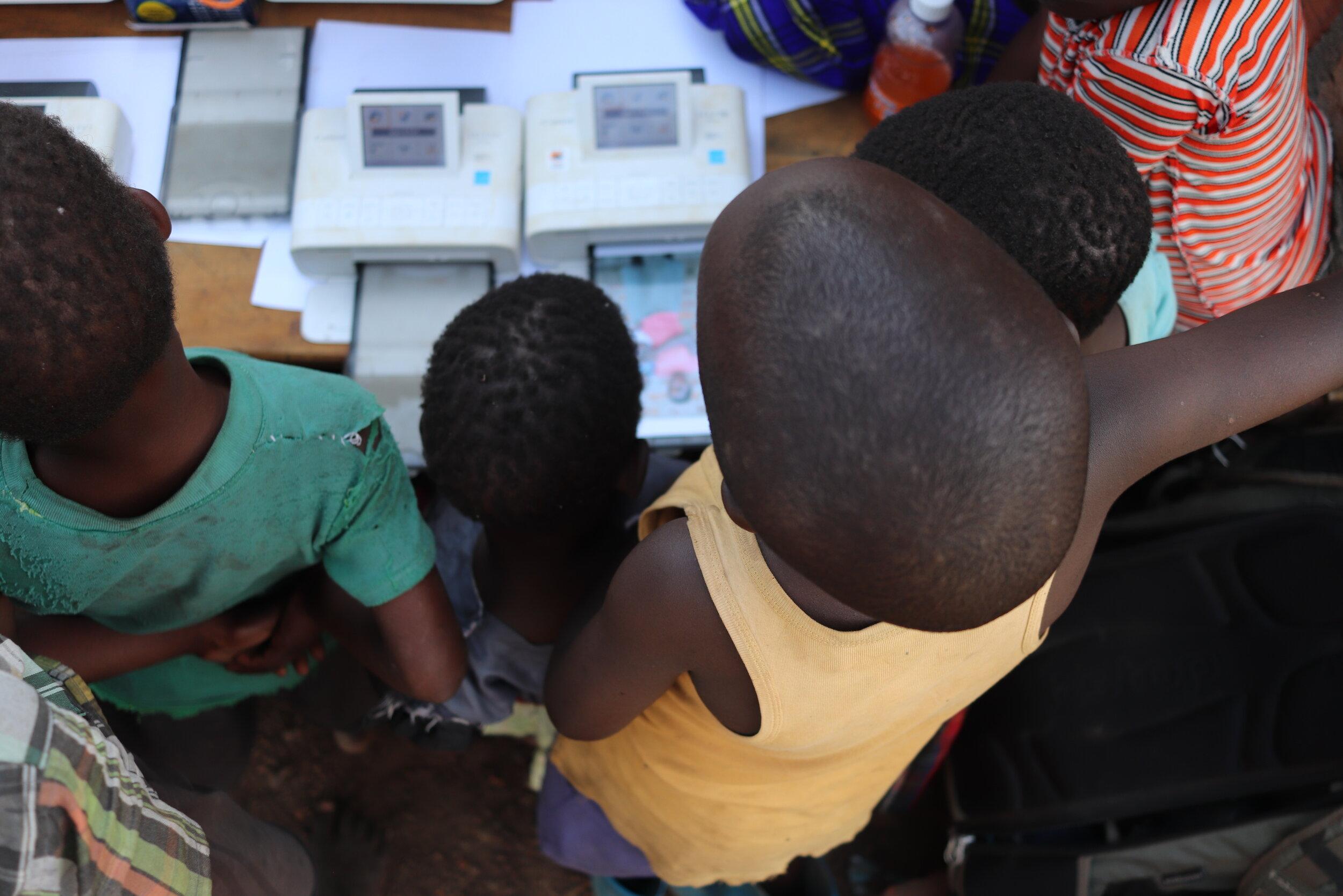 Kids watch printers.JPG