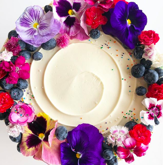 A signature style flower-clad cake by  Goldenrod Pastries on Instagram.
