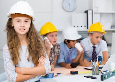 93688020-teenager-girl-engineer-and-children-near-laptop-with-plan-in-the-office.jpg