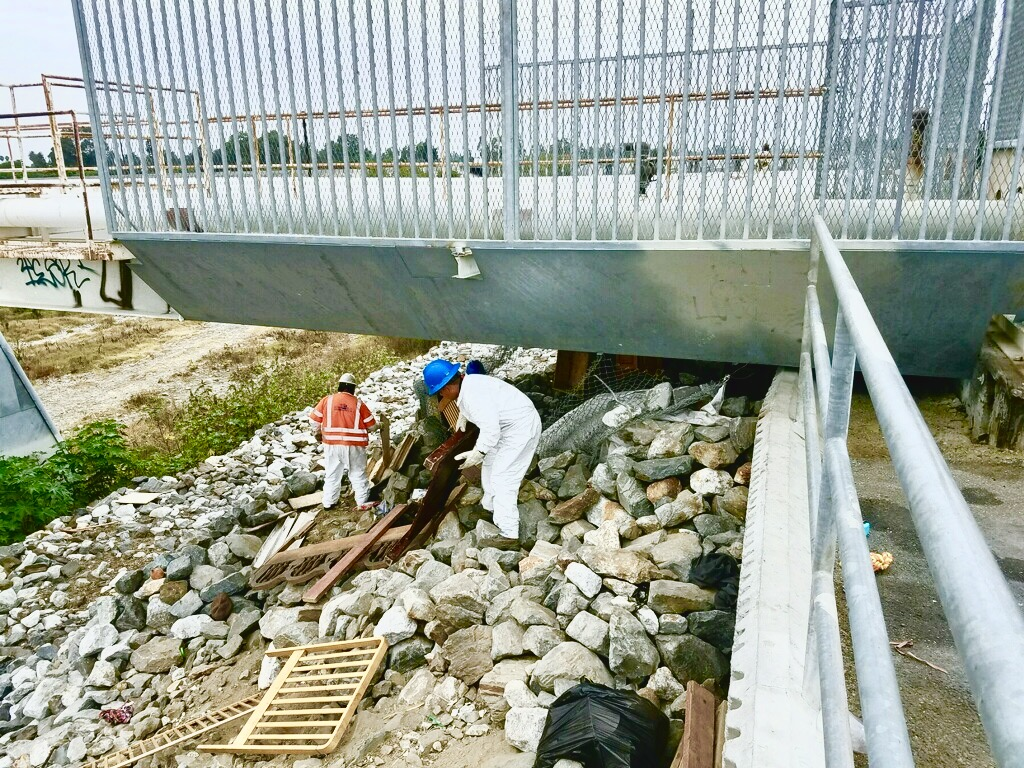 Removing debris from underpasses
