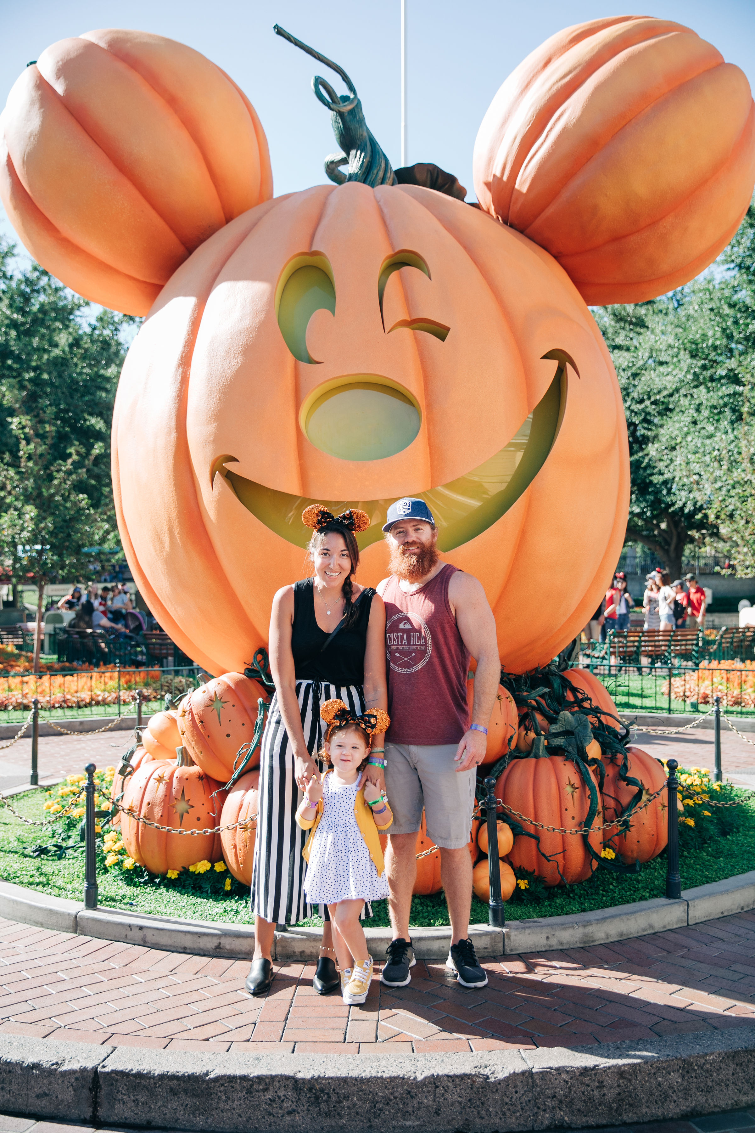 The most popular spot for Halloween Time family photos is in front of the giant Mickey Mouse pumpkin which is inside Disneyland! It is so cute and right at the entrance to Main Street, you won't miss it. You may have to wait in line. I'd try and get to the park when it opens and snag your photos first thing.