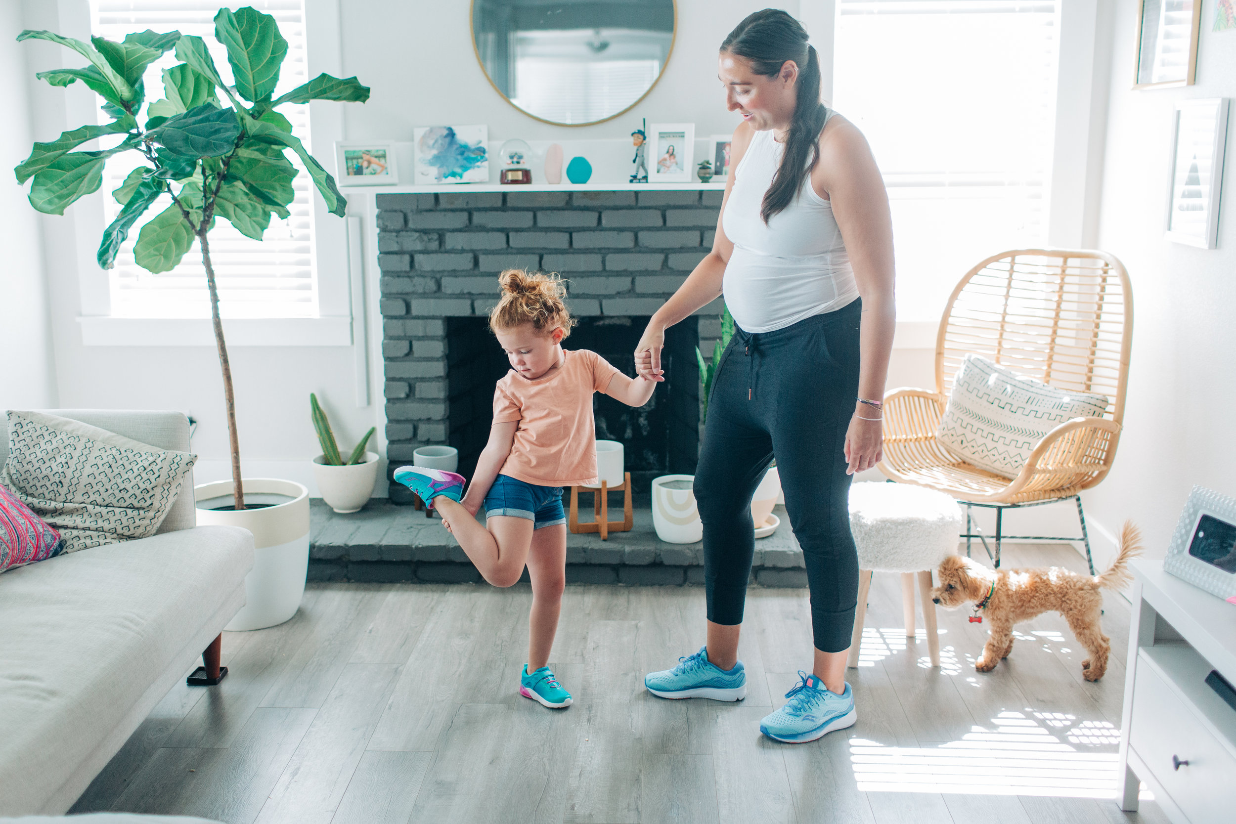Since I'm pregnant and not running right now, I try and get outside with Mila everyday for some physical activity. We always start by doing a little stretching inside!