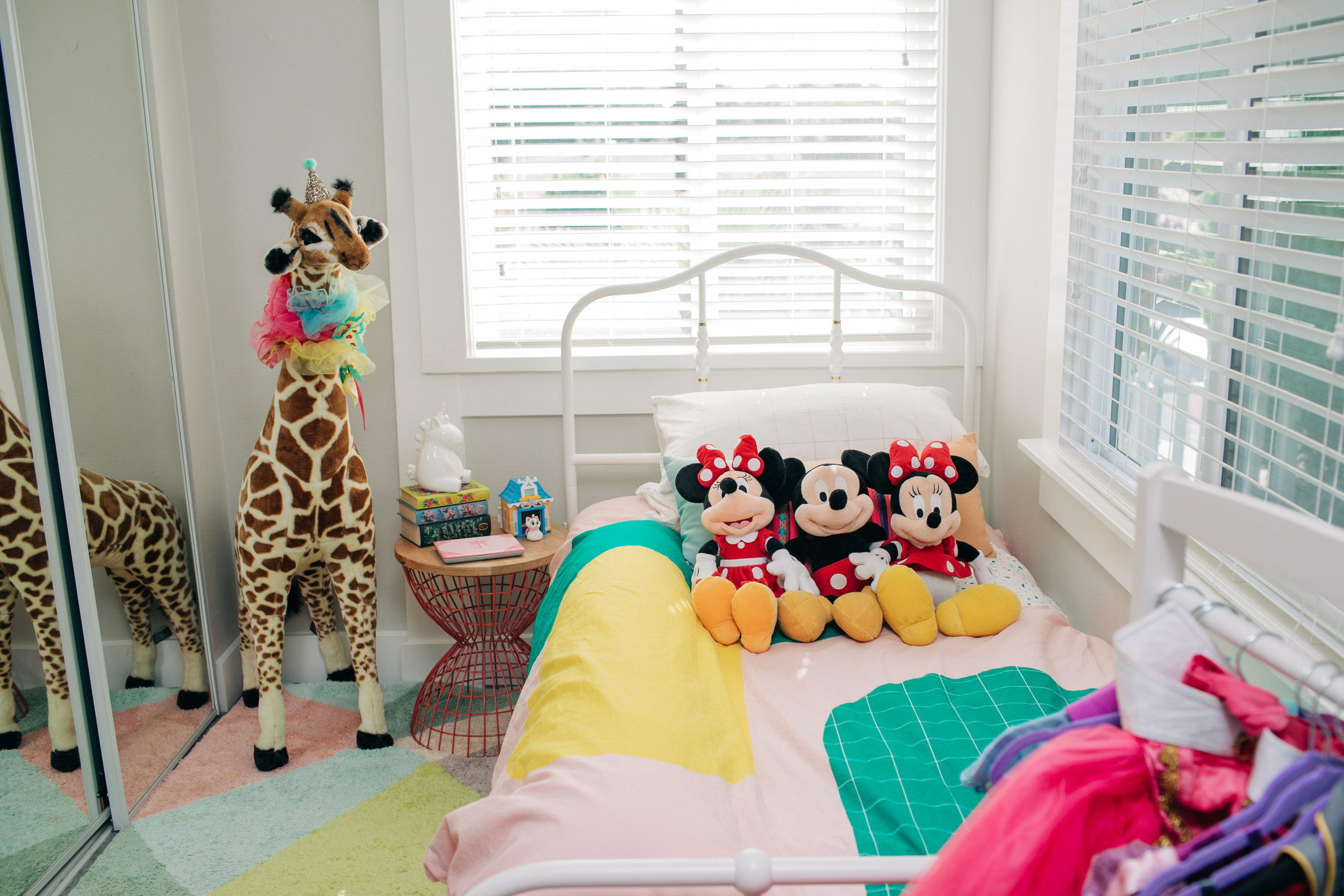 Earlier this year we finally swapped out Mila's toddler bed for a twin bed. This one we bought from Ikea. The fun bedding is from Ikea as well. We always keep the Mickey and Minnies on her bed. The Mickey we bought when we had Ryan. One Minnie we bought when we had Mila. The third Minnie we bought and used to reveal we are having another girl.